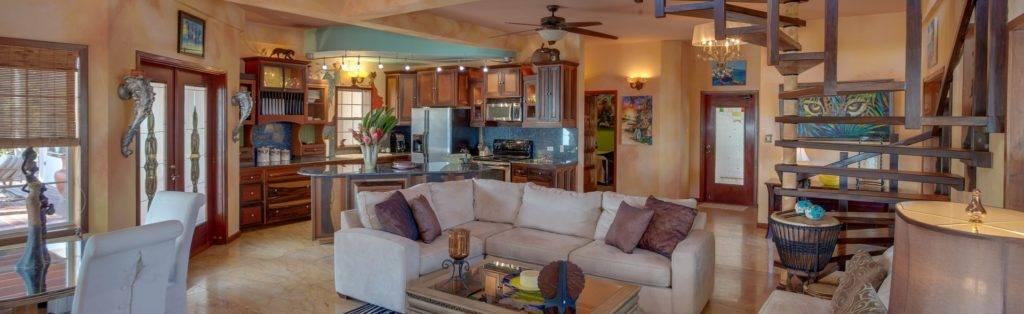 Spacious, modern villa living room, dining room, and kitchen at Chabil Mar Villas.